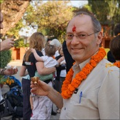 Atlantic sponsor Doug Sheperdigian enjoys the blessing ceremony