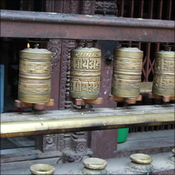 Prayer wheels in the golden palace