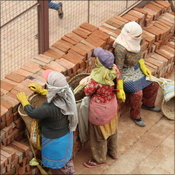 Female labourers take a break from rebuilding Patan