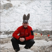 Nigel with bunny ears in front of ice fall