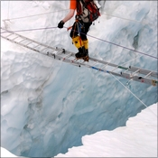 Crossing a crevasse in the Khumbu icefall