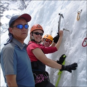 Jamling teaching Gwen & Liesl ice-climbing techniques